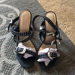 Brand new pair of black and silver hills.